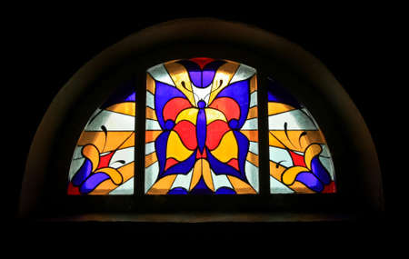 vitrage: Stained glass with colored butterfly and flowers