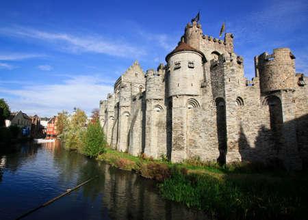 Old castle Gravensteen near river in Gent