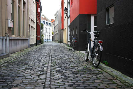 Bicycle on empty old street Standard-Bild