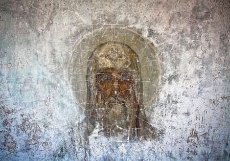 saintliness: Old orthodox religious fresco on the wall