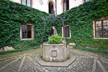 Old well in the courtyard of the Sychrov castle