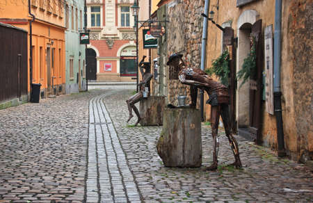 pavers: PLZEN, CZECH -JAN 10,2016: Strange statue from scrap metal near Old Malt House Tavern, focusing on authentic experience of the Middle Ages.
