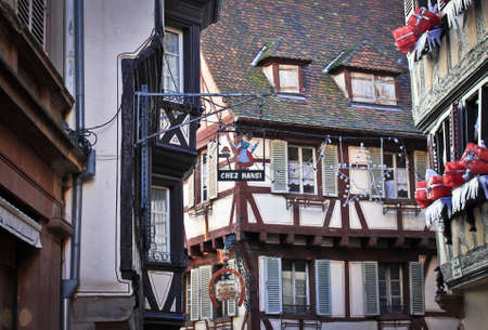 COLMAR, FRANCE -JAN 09,2015:  Rue des Marchands. Colmar is the third-largest commune of the Alsace region in north-eastern France. Christmas decoration of city