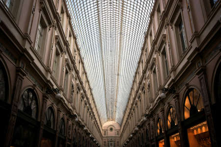 preceded: BRUSELLS, BELGIUM -NOV 03,2015: The Galeries Royales Saint-Hubert is a glazed shopping arcade in Brussels that preceded other famous 19th-century shopping arcades