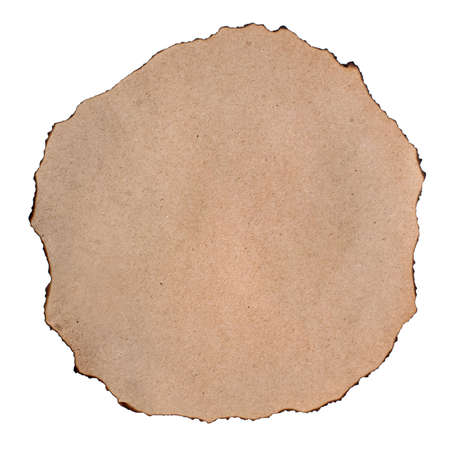 A round sheet of rough brown paper with burnt edges. Copy space Stock Photo