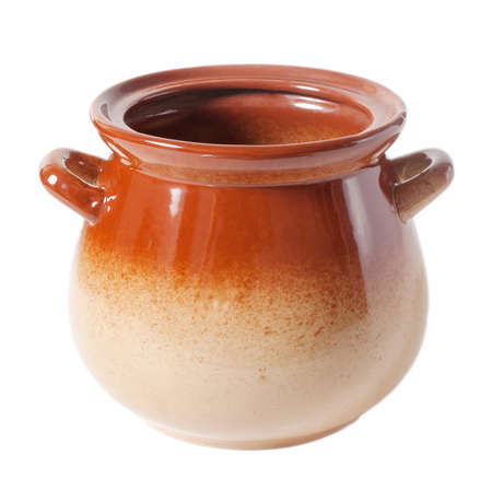 Open brown clay pot without a lid on a white background
