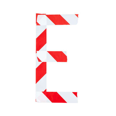 Letter E from red and white warning tape. Isolated on white background Stock Photo