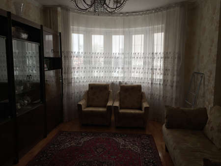 A typical living room in Russia. A carpet, an old sideboard, armchairs - all this is found in almost every apartment in the post-Soviet space.