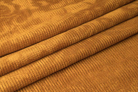 Orange fabric with three pleats in the middle Stok Fotoğraf