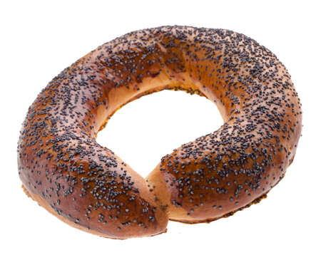 Ruddy bagel sprinkled with poppy seeds on top, on a white background Standard-Bild
