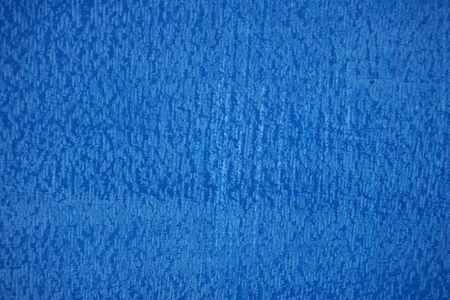 Blue concrete wall texture. Blue painted concrete wall background.