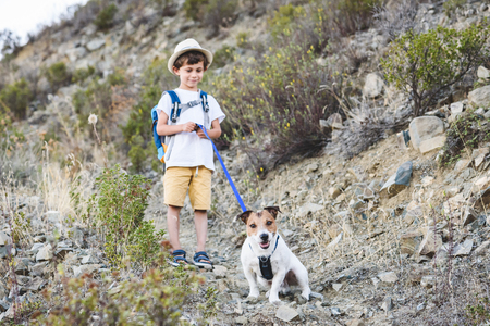 Kid with pet hiking by dog friendly trails