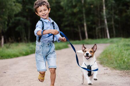 Happy boy running with dog
