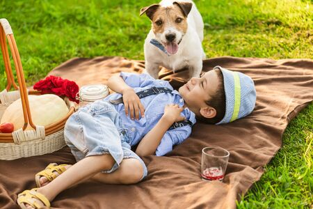 Boy playing with dog at picnic