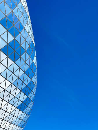 Abstract modern building concept: roof with geometric pattern of football (soccer) stadium against blue sky