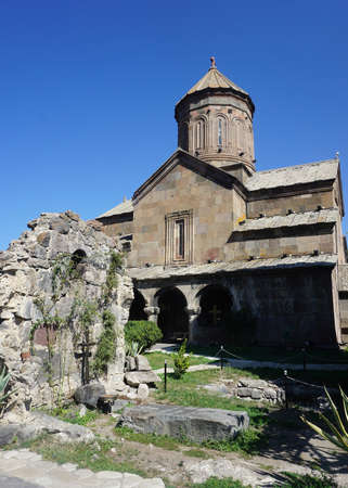 Zarzma Monastery Church with Grave View and Blue Sky