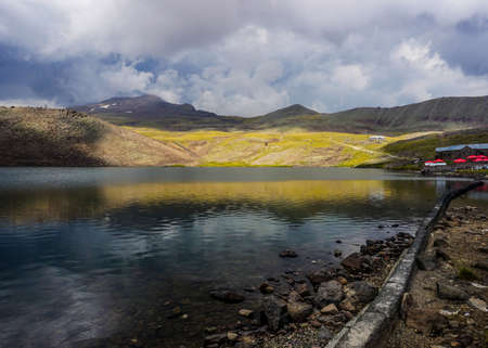 Mount Aragats Lake on the Mountain Peak with Cloudy Sky 免版税图像