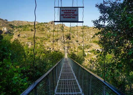 Goris Khndzoresk Hanging Bridge Entrance with Armenian Warning Letters Stock fotó - 112348631
