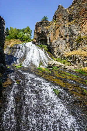 Jermuk Flowing Waterfall Scenic Spot with Rock in Summer with Blue Sky