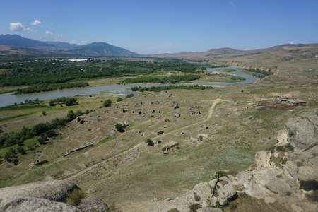 Uplistsikhe Fortress and Housing Ruins with River Forest and Landscape View