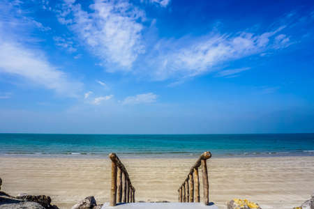 Ras Al Kaimah Sandy Beach with Downstairs and Picturesque Blue Sky Background Stok Fotoğraf