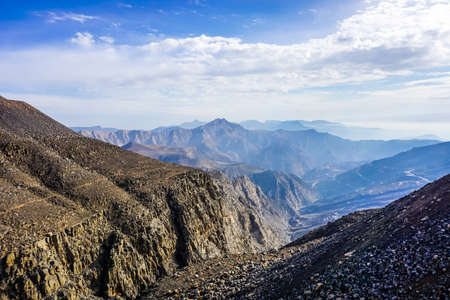 Jebel Jais Mountain Picturesque View of Mountain Peaks with Cloudy Blue Sky