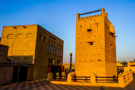 Dubai Al Shandagah Watch Tower Frontal View at Sunset with Picturesque Blue Sky Background Banco de Imagens