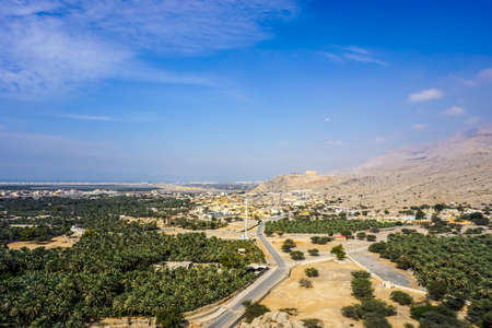 Ras Al Kaimah Suburbs Dhayah Fort Picturesque Palm Trees Landscape with Blue Sky Horizon View
