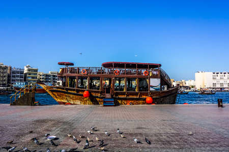 Dubai Creek Side View of Anchored Ship with Pigeons at the Shore