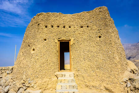 Ras Al Kaimah Dhayah Fort Tower View on the Hill with Picturesque Blue Sky Background