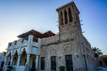 Dubai Heritage Village Traditional Windcatcher Building with Picturesque Blue Sky Background Editorial