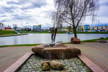 Minsk Island of Tears Crying Angel in Front of Svislach River and Old City View Editorial