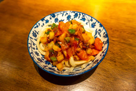 Chinese Xinjiang Lagman Noodles in a Small Plate with Blue Ornaments Stock fotó