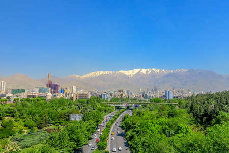 Tehran Ab-o Atash Park with View of Snow Capped Mount Tochal Alborz and High Traffic Highway
