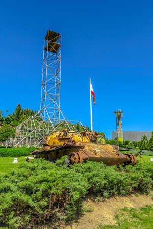 Tehran Ab-o Atash Park with View of Iran Flag Tower and Rusted Damaged Tank Banco de Imagens
