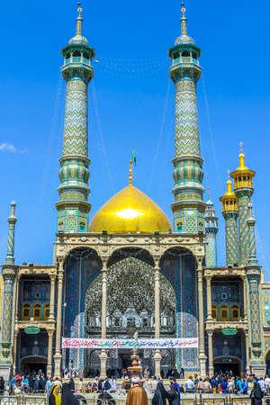 Qom Fatima Masumeh Shrine Front View with Minarets and Crowd