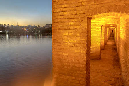 Isfahan Allahverdi Khan Si-o-Seh Pol 33 Arches Bridge Illuminated Corridor Sunset with Zayandeh Rood River View