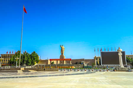 Kashgar Peoples Park Square Mao Zedong Statue with Chinese Waving Flag Stock Photo