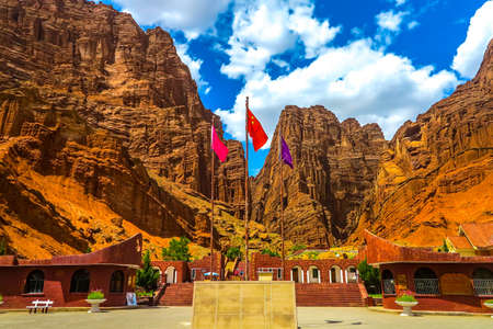 Tianshan Mysterious Grand Canyon Main Entrance Gate with Chinese Waving Flag View Point Stock Photo