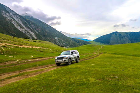 Grigorievka Gorge in Kyrgyzstan with Kungei Ala Too Mountain Range Forest Car Road Track Jeep