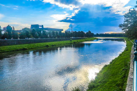 Uzhhorod Uzh River with View of the Zakarpattia Regional State Ukrainian Music Theatre at Background 스톡 콘�츠
