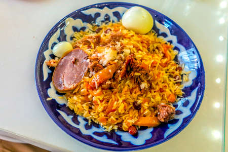 Uzbek Traditional Lamb Pilaf Meat Chunks Carrots Eggs and Raisins with Rice Banco de Imagens