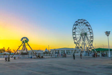Mary Turkmenistan Amusement Park with Big Ferris Wheel at Sunset