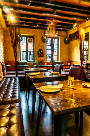 Chic Comfortable Ambience Restaurant With Prepared Cutlery and Plates