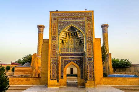 Samarkand Gur-e Amir Complex Mausoleum Main Gate Entrance View Iwan Muqarna Honeycomb Stalactite Vaulting at Sunset