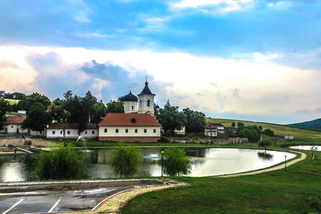 Capriana Monastery Complex Full View with Lake and Landscape Cloudy Day