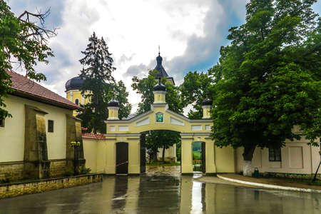 Capriana Monastery Complex Main Gate Entrance View with Rainy Clouds