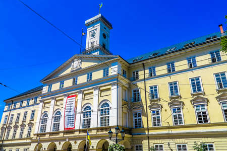 Lviv Town Hall Side Low Angle View with Waving Ukrainian Flag on Roof Stok Fotoğraf