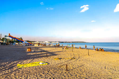 Odessa Luzanivka Beach Swimming Relaxing and Sunbathing People with Seascape During Sunset