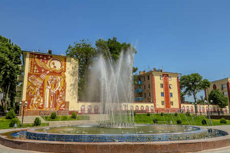 Samarkand Amir Temur Park Fountain with Uzbek Women Wearing National Costume Depicted on a Building from Soviet Era